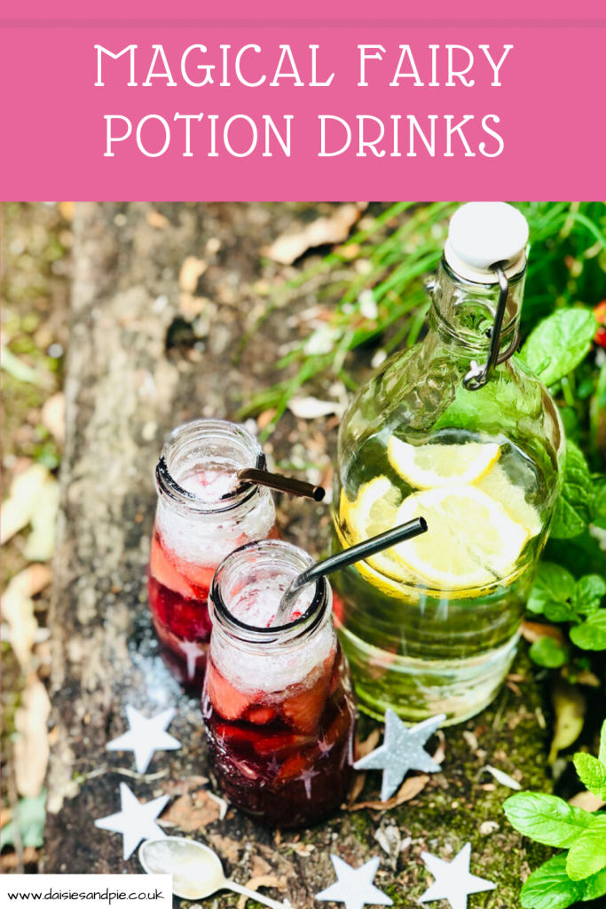"fairy potion drinks with edible glitter, strawberries, raspberries and red berry cordial, surrounded by silver stars on an old wooden sleeper in the garden. Text ""magical fairy potion drinks"""