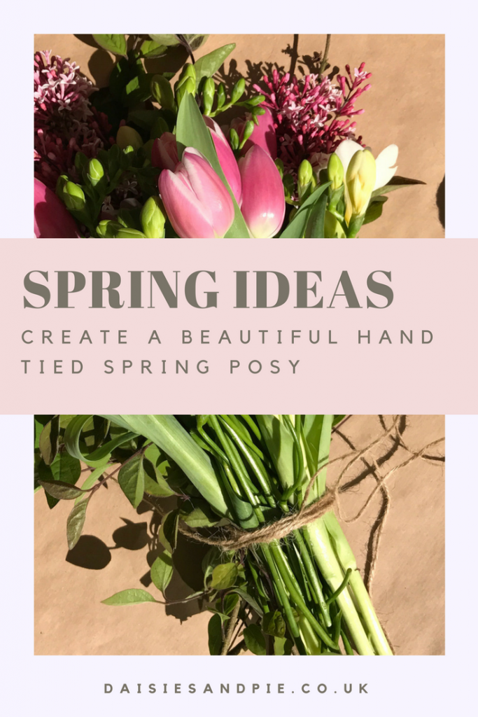"""beautiful simple hand tied spring post with lilac, tulips and freesia tied with brown string. Text overlay saying """"spring ideas create a beautiful hand tied spring post"""""""
