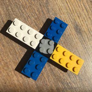 LEGO fidget spinner on a wooden laminate floor