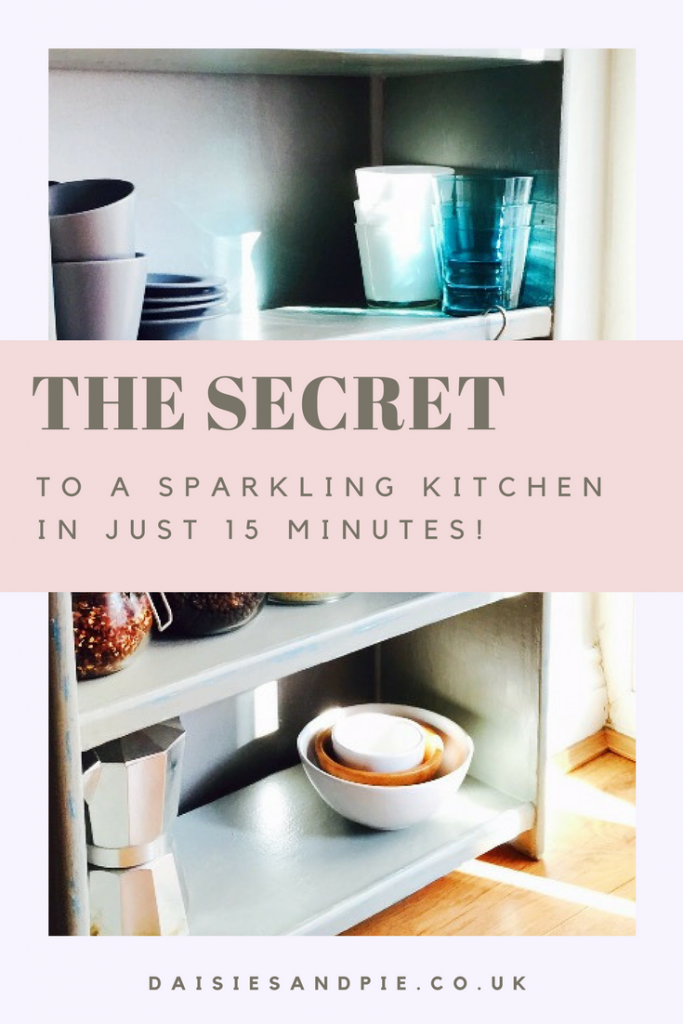 "grey painted shelves with cups and saucers, glasses, bowls and a coffee pot stored on them. Text overlay saying ""the secret to a sparkling kitchen in just 15 minutes"""