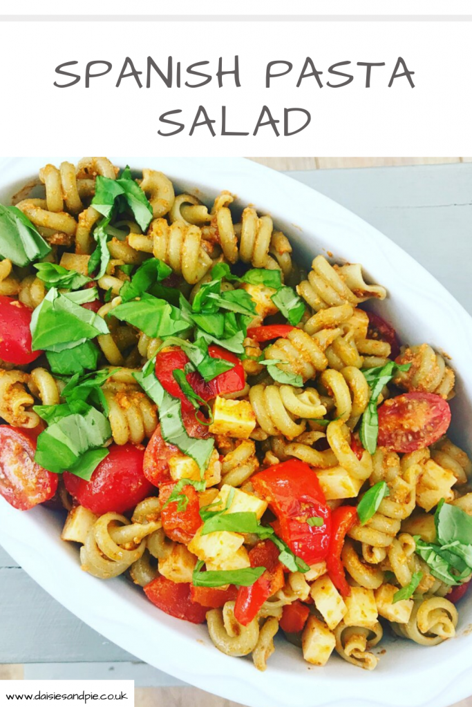 bowlful of Spanish pasta salad with tomatoes and manchego cheese