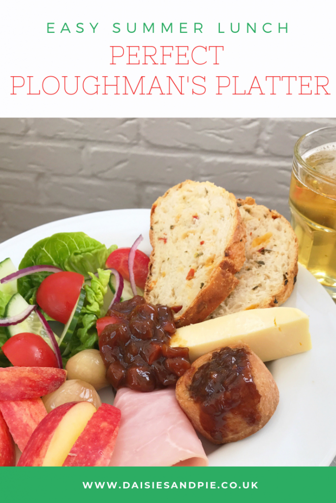 ploughman's lunch with bread, cheese, salad, pork pie, pickle, cheese and apples