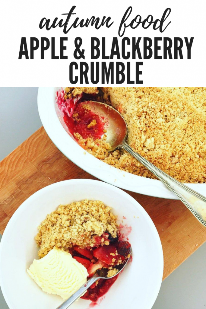 """bowlful of homemade easy apple and blackberry crumble served with vanilla ice cream. Text overlay """"autumn food - apple and blackberry crumble"""""""