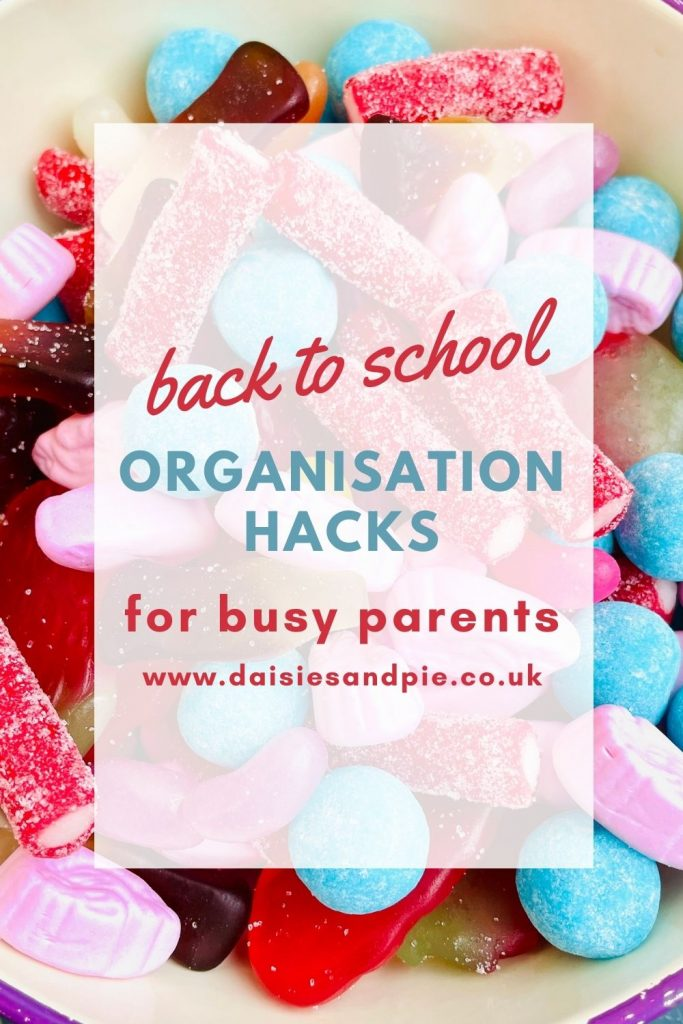 """Text overlay reads """"back to school organisation hacks for busy parents"""" text is over a large bowl of pick and mix sweets"""