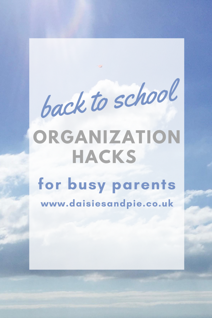 """blue sky with white fluffy clouds. Tex overlay """"back to school organization hacks for busy parents"""""""