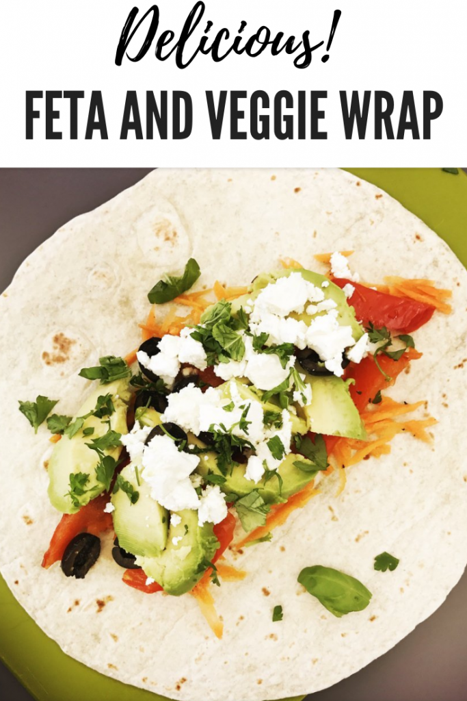 Feta and Veggie Wrap with Carrot Slaw, healthy vegetarian sandwich recipes, easy lunch ideas. text overlay reads 'delicious! feta and veggie wrap'