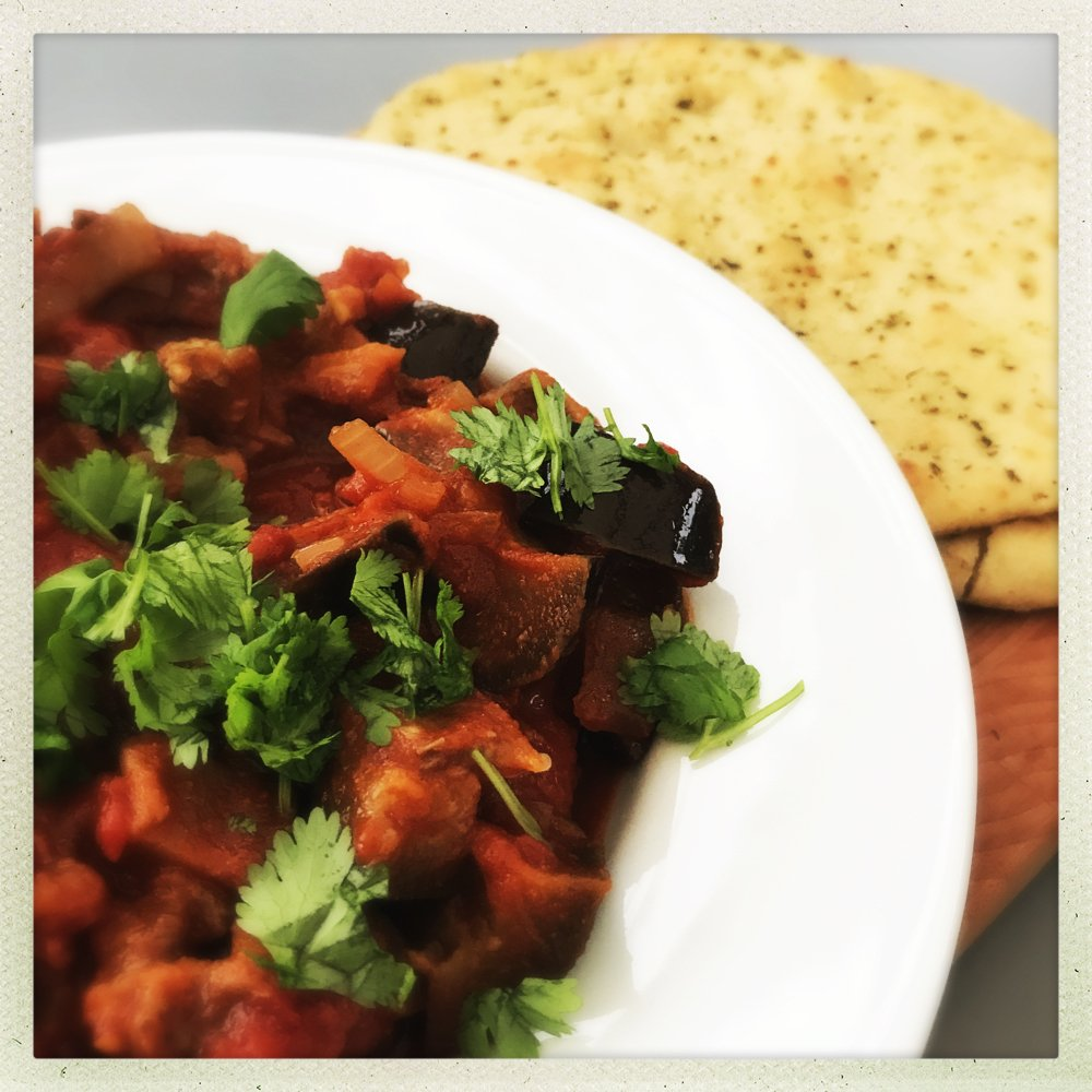 Quick and easy vegetarian dinner perfect for midweek when you're busy, tomato and aubergine stew with garlicky naan bread, quick dinner ideas