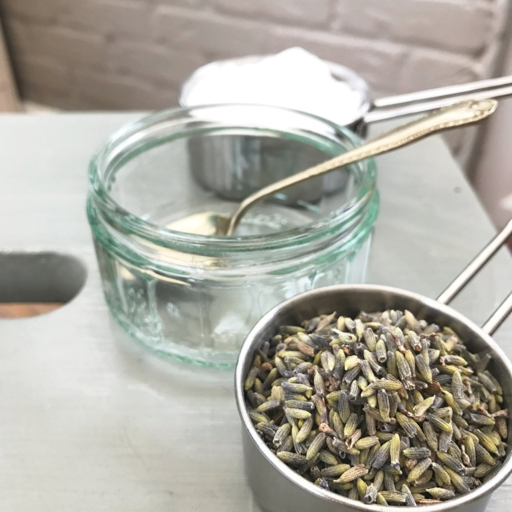 ingredients for homemade carpet freshener - cup of dried lavender, cup of baking soda and glass jar for mixing with a spoon
