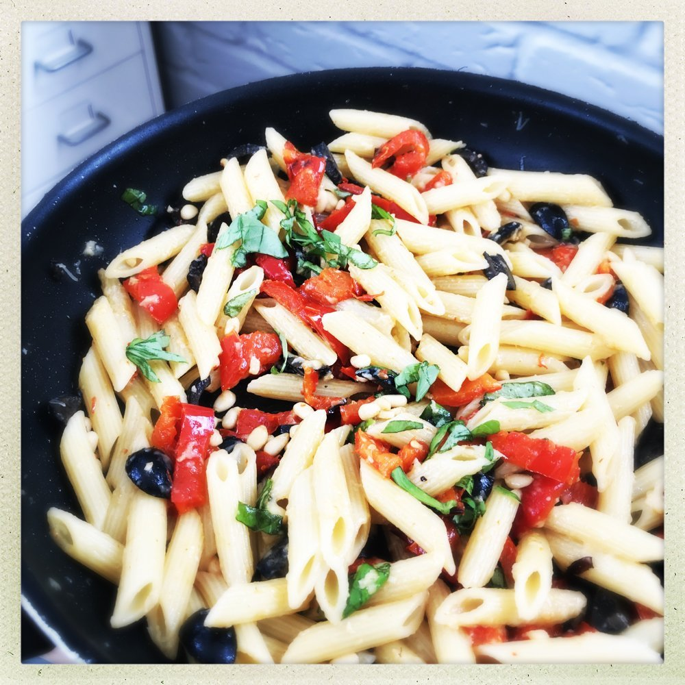 panful of red pepper and pine nut pasta with black olives