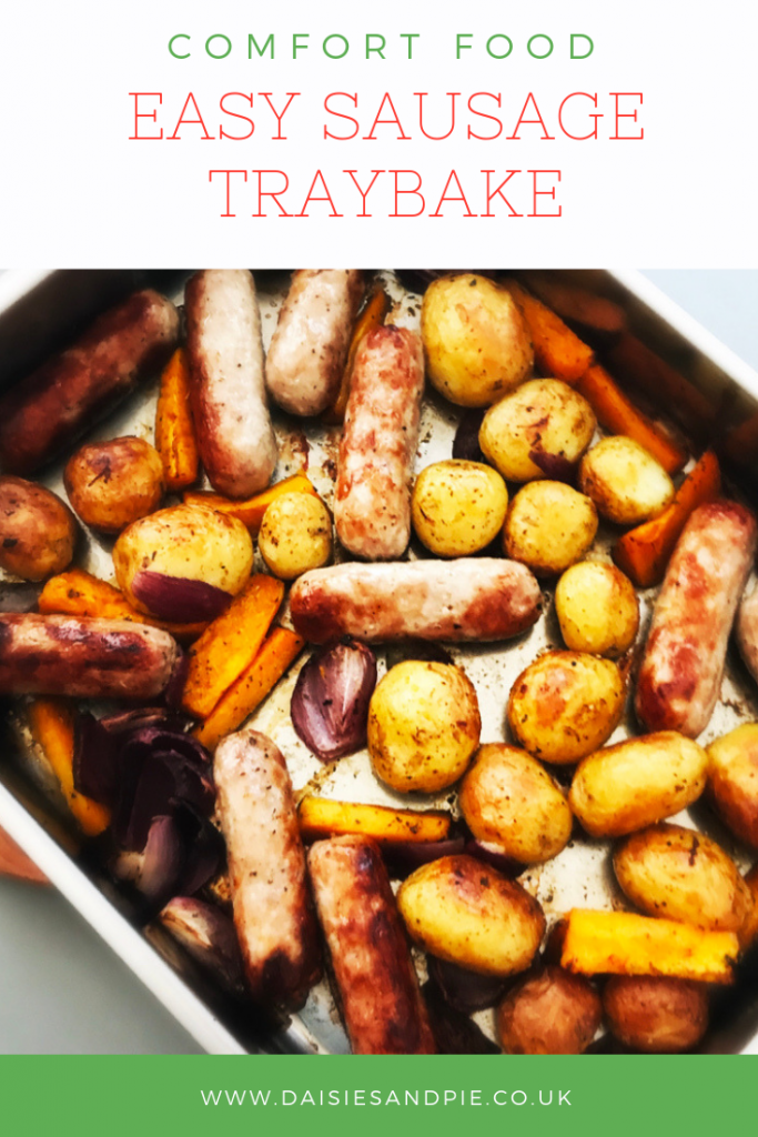 "sausage traybake with sausages, butternut squash, onions and new potatoes. Text overlay saying ""comfort food - easy sausage traybake"""