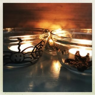 how to make easy Halloween tea light holders, spooky homemade Halloween decorations, halloween dinner party ideas