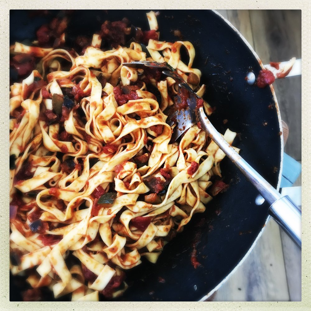 panful of vegetable ragu tossed through fresh tagliatelle