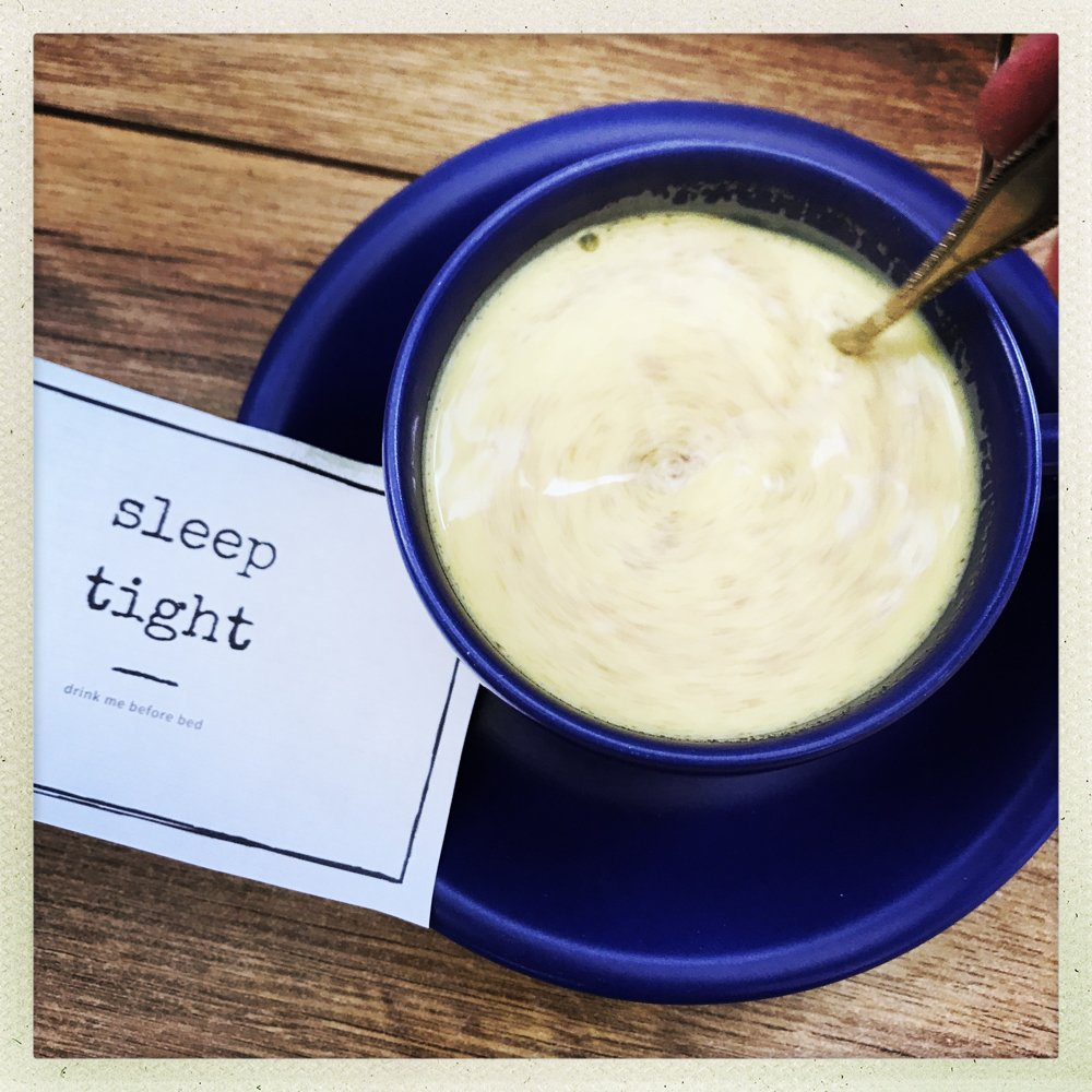 a cup of soothing turmeric milk drink with note saying sleep tight