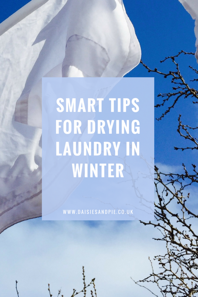 """white shirts drying on the washing line on a winter day. Text overlays saying """"smart tips for drying laundry in the winter"""""""
