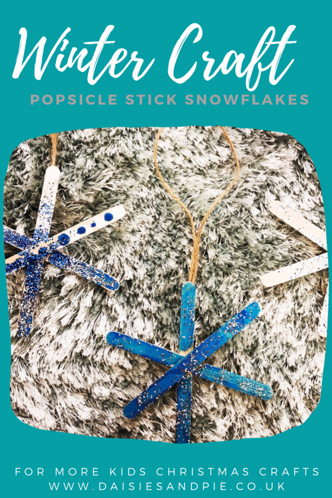 """snowflake ornaments made from popsicle sticks painted and sprinkled with glitter. text overlay """"winter craft - possible stick snowflake - for more Christmas crafts - www.daisiesandpie.co.uk"""""""