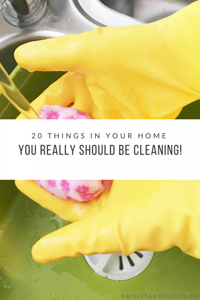 """green joseph joseph washing up bowl with water running into it - hands with yellow rubber gloves on wetting a pink and white cloth under the water. Text overlay saying """"20 things in your home you really should be cleaning"""""""