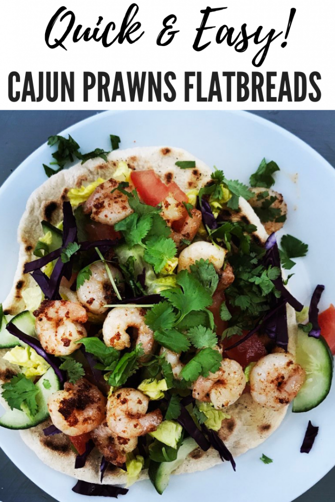 "cajun prawns flatbreads with salad and herbs. Text overlay ""quick and easy cajun prawns flatbreads"""