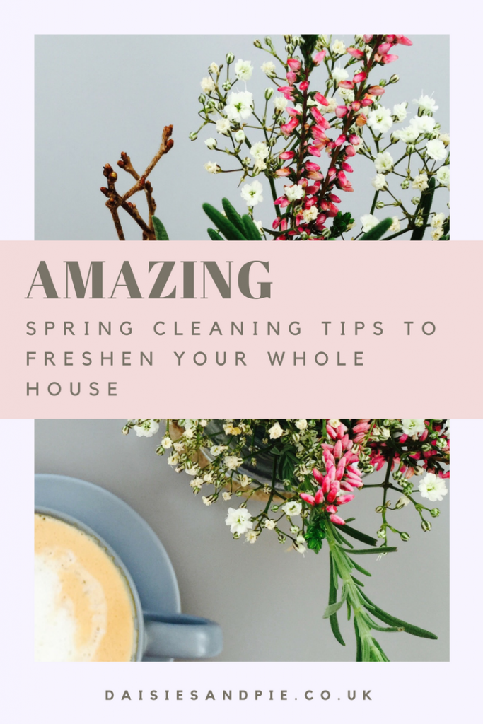 "Grey table top with a cup of coffee in a small dusky blue cup and saucer from IKEA next to a jam jar filled with spring flowers and herbs from the garden. Text overlay saying ""amazing spring cleaning tips to freshen your whole house"""