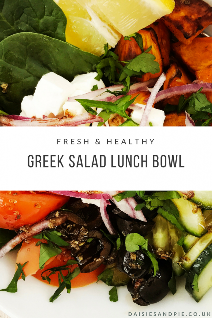 "bowl of greek salad with spinach, vine tomatoes, cucumber, black olives, roast sweet potatoes, feta cheese, red onion and balsamic salad dressing. Text overlay saying ""fresh and healthy Greek salad lunch bowl"""
