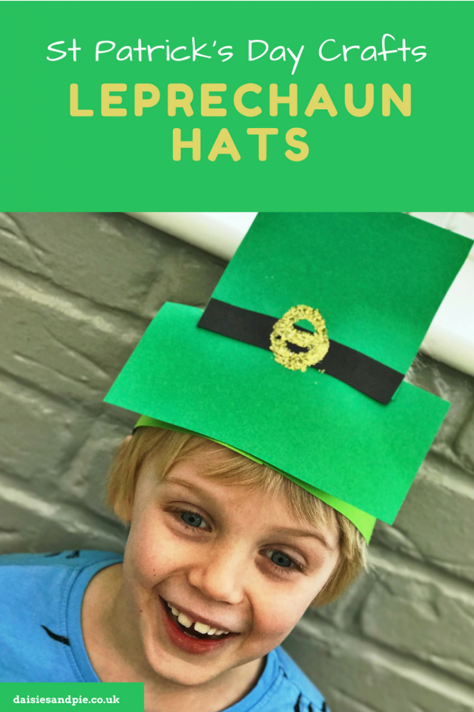 "blonde boy wearing a dinosaur top and a homemade leprechaun hat. Text overlay says ""St Patricks Day Crafts Leprechaun Hats"""