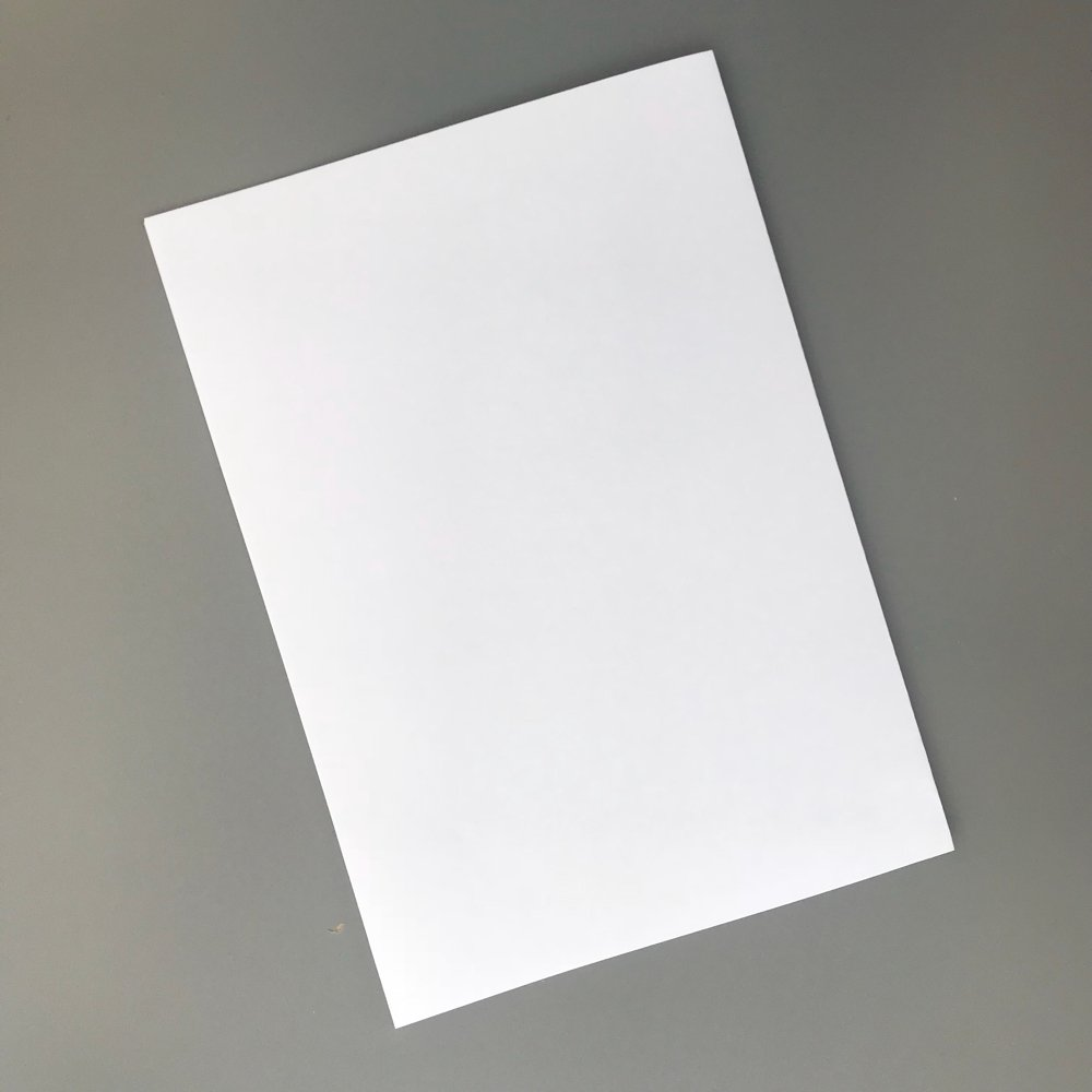 sheet of white A4 paper folded in half