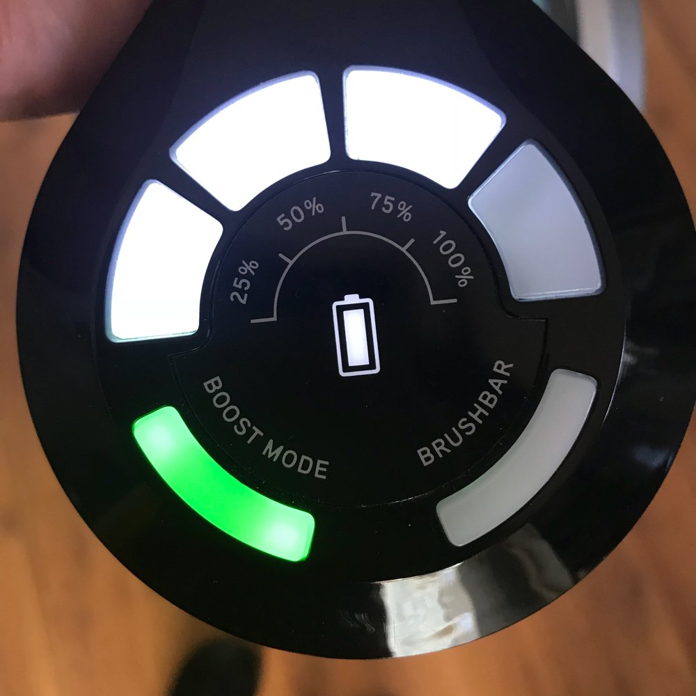 Vax Blade smart control panel showing battery power at 75%, boost mode button lit up in green and the brushbar button off