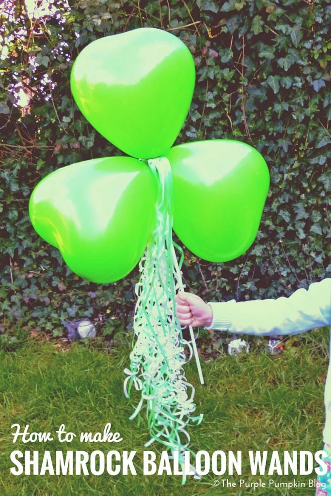 "shamrock ballon wand being held by small girl. Text overlay saying ""how to make shamrock balloon wand"""