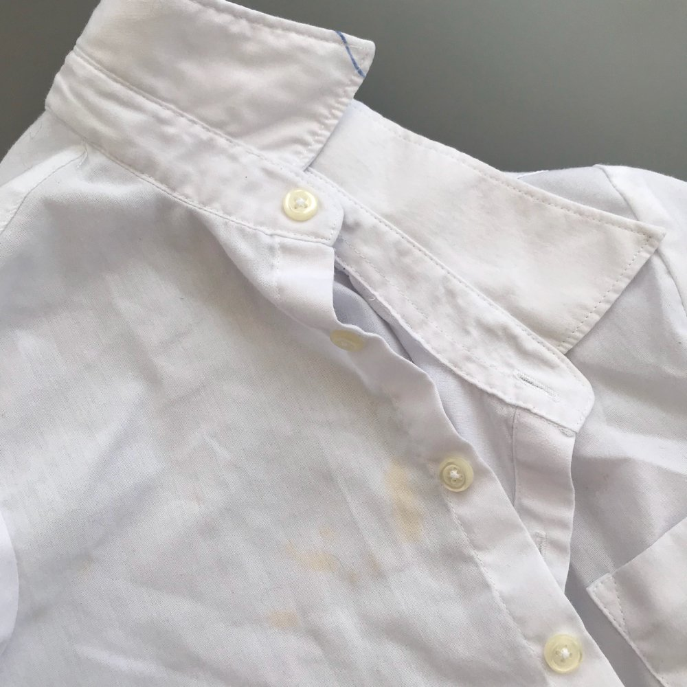 kids white school shirt with curry stain down the front