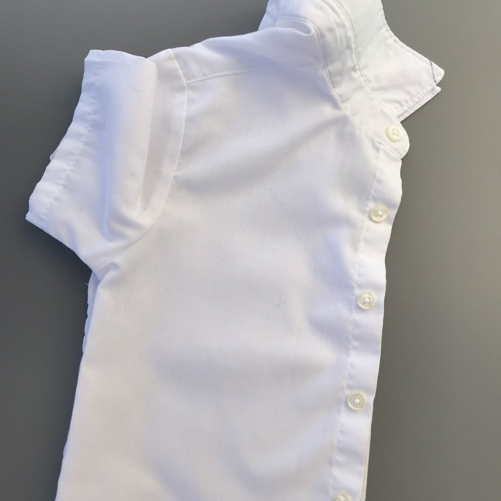 kids white school shirt with no stains having been washed with ACE laundry bleach for whites