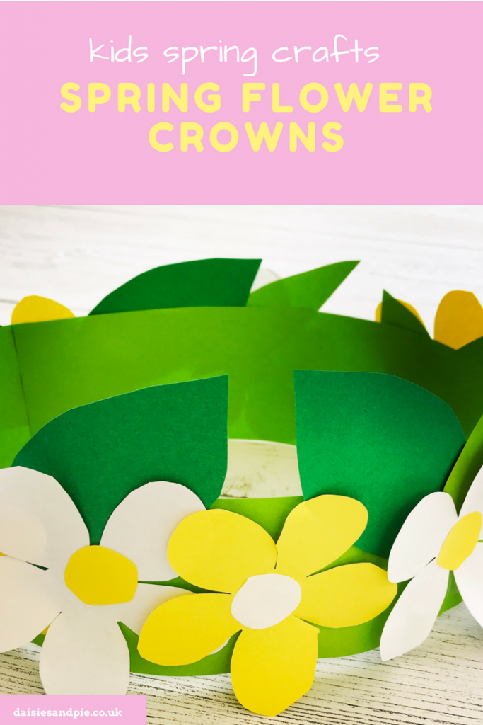 """white wooden table with spring paper flower crown made from green, white and yellow paper. Text overlay saying """"kids spring crafts spring flower crowns - www.daisiesandpie.co.uk"""""""