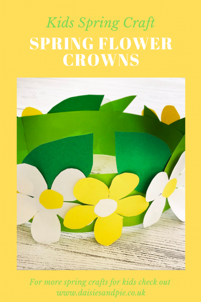 """white wooden table with spring flower crown made from green, white and yellow paper. Text overlay saying """"kids spring crafts spring flower crowns - www.daisiesandpie.co.uk"""""""