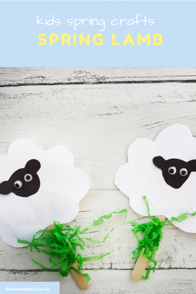 "white table with two child made sheep pop up puppets on lolly sticks. Text overlay saying ""kids spring crafts - spring lamb"""