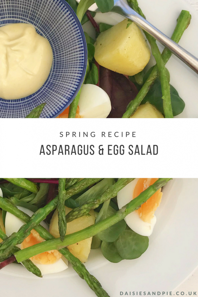 """white plate with asparagus and egg salad with baby new potatoes and a mustard mayonnaise dip in a small blue and white bowl. Text overlay saying """"spring recipe asparagus and egg salad"""""""