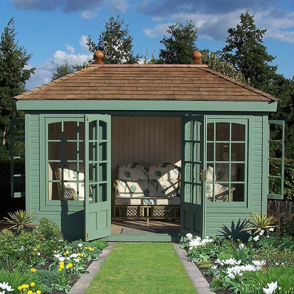 Malvern 2 summer house from GBC group in green with whicker seating set inside
