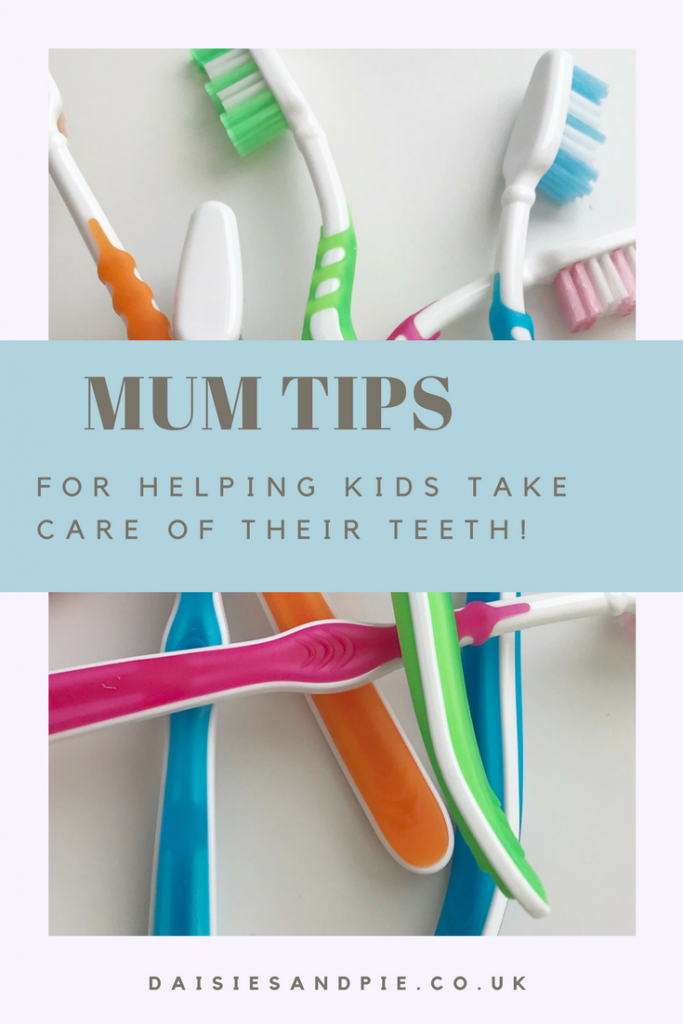 "pile of coloured toothbrushes on a white table. Text overlay saying ""mum tips for helping kids take care of their teeth"""