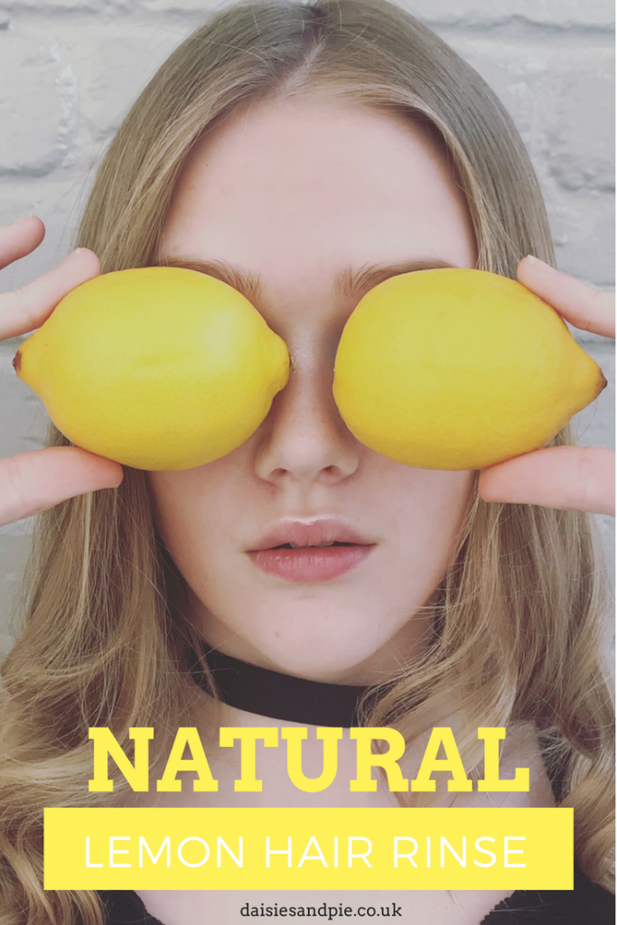 "photo of a teenage girl with blonde hair holding lemons up in front of her face. Text overlay saying ""natural lemon hair rinse"""
