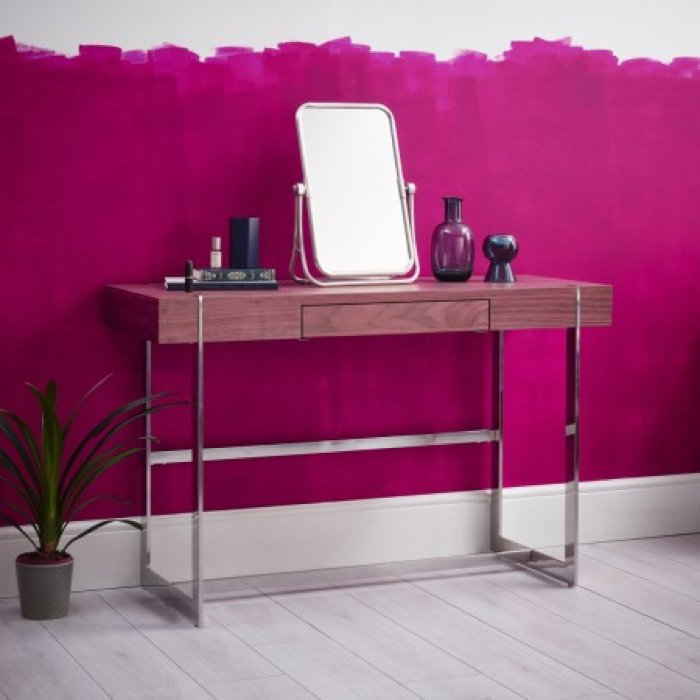 dressing table desk with free standing mirror against a bright pink painted wall with pot plant to the side