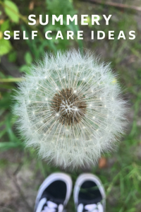 """close up of dandelion in seed with trainers in the back ground. Text overlay saying """"summer self care ideas"""""""