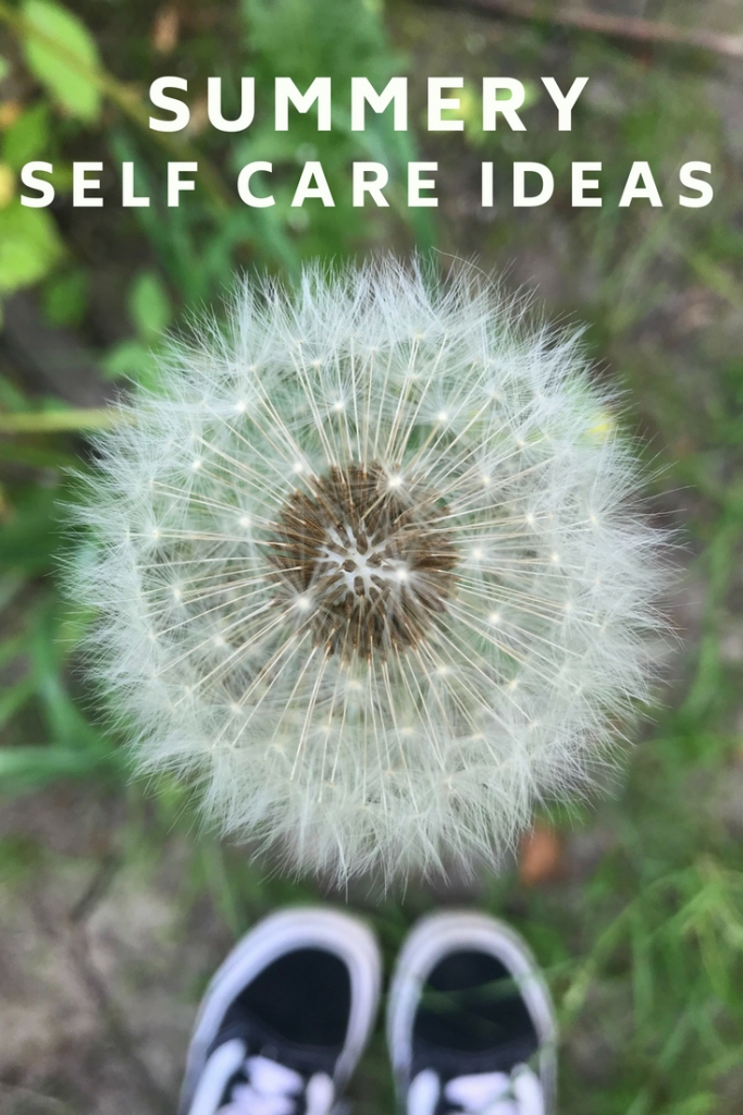 "close up of dandelion in seed with trainers in the back ground. Text overlay saying ""summer self care ideas"""
