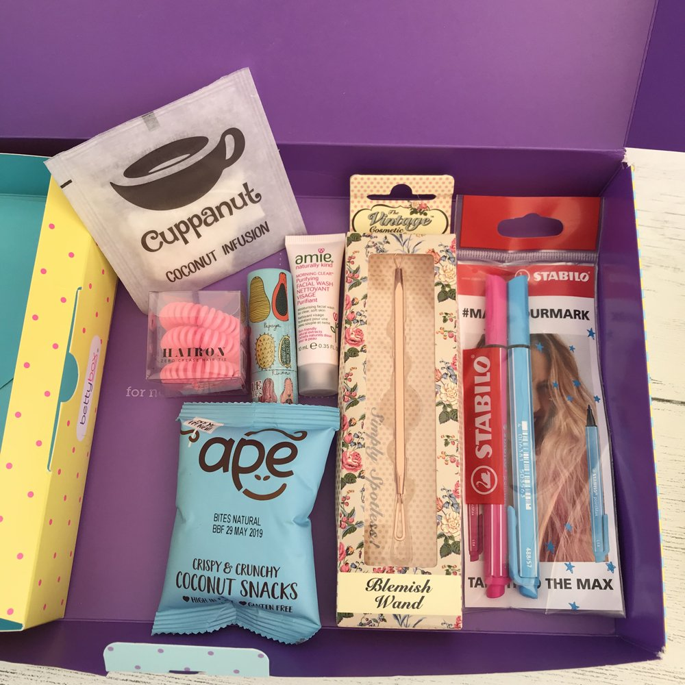 gifts inside the bettybox period subscription box for girls - bobbles, teabags, snacks, pens, lip balm