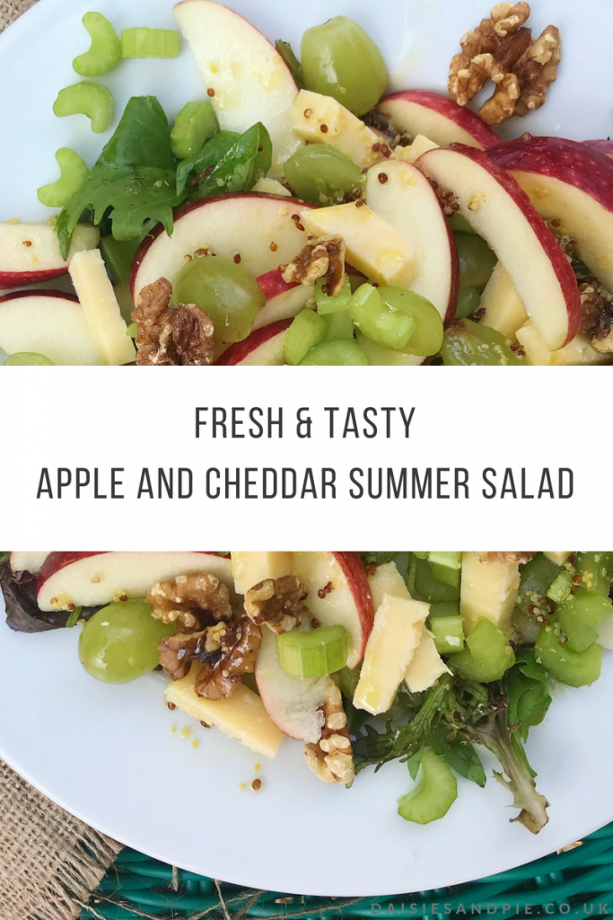 "plate of homemade apple and cheddar salad with salad leaves, celery, walnuts, apples and mustard dressing. Text overlay saying ""fresh and tasty apple and cheddar summer salad"""