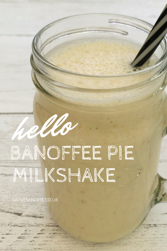 "white wooden table with kilner jar filled with homemade banana milkshake with black and white straw. Text overlay saying ""hello banoffee pie milkshake - daisiesandpie.co.uk"""