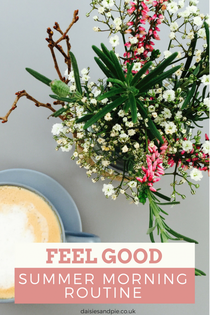 """jam jar filled with summery flowers and herbs alongside a cup of real coffee. Text overlay saying """"feel good summer morning routine"""""""