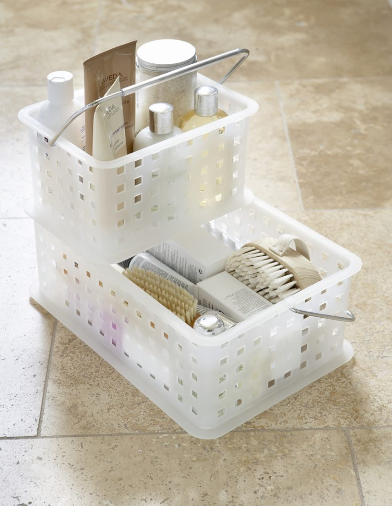 plastic stackable crates filled with bathroom products