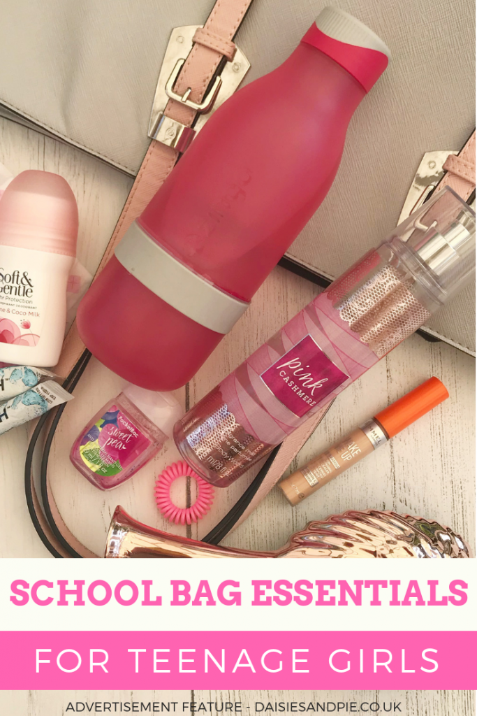 "a collection of school bag essentials for teenage girls - pink water bottle, deodorant, bobbles. hand sanitiser, toothpaste, concealer, body spray, hair brush. Text ""school bag essentials for teenage girls"""