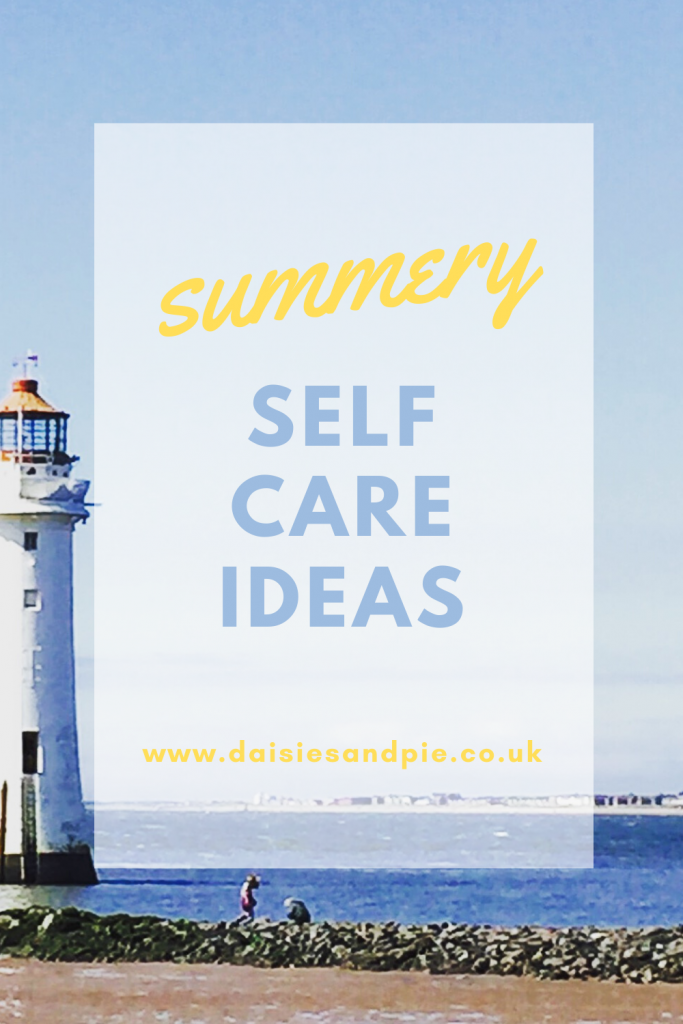 """lighthouse with brilliant blue sky and sea in the background. Text overlay """"summery self care ideas"""""""