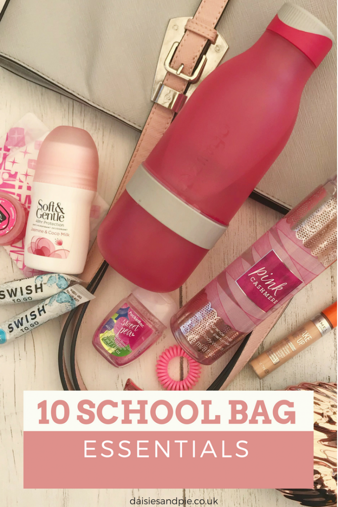 "pale grey bag with pink straps wit bag contents laid alongside - zingo bottle, soft and gentle deodorant, swish toothpaste, sanitary towels, lipgloss, bobbles, hand sanitiser, concealer, body spray, tangle angel hairbrush. Text overlay saying ""10 school bag essentials"""