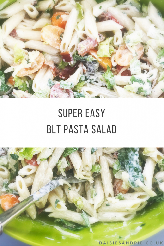 """green joseph jospeh bowl filled with homemade BLT pasta salad with homemade ranch dressing. Text overlay saying """"super easy BLT pasta salad www.daisiesandpie.co.uk"""""""