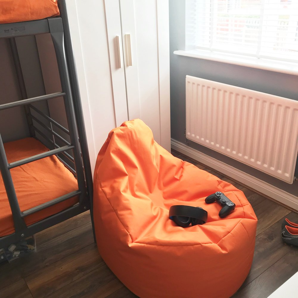 teenage boys bedroom with bunkbeds, Bonkers gamer beanbag and orange accent colours