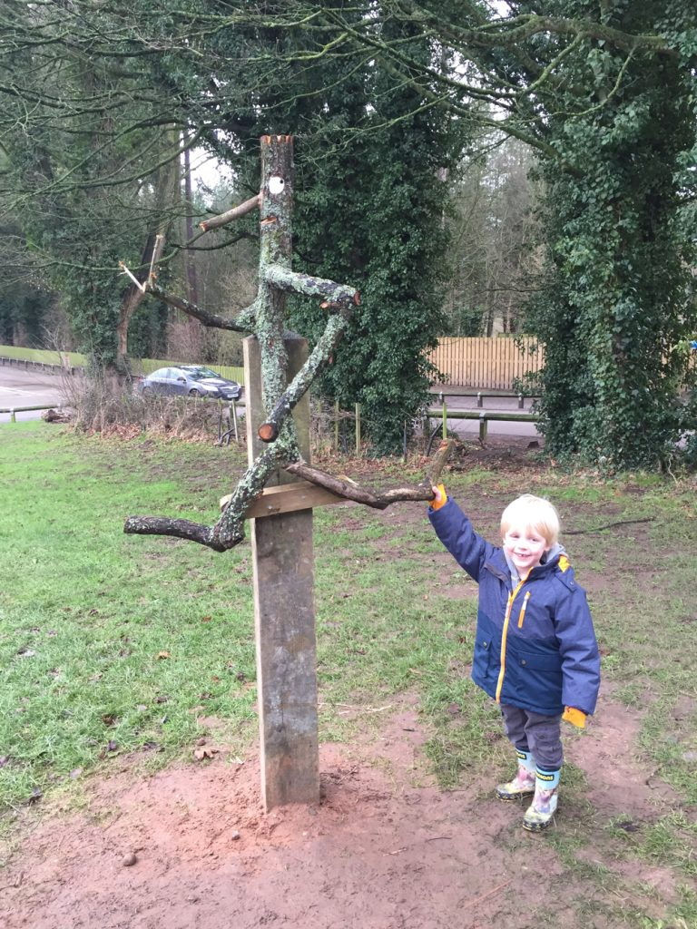 small boy holding onto the stickman at Delamere Forest Gruffalo trail